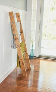 Industrial decor meets rustic farmhouse with a twist. This wooden ladder has a reclaimed wood appearance yet it looks sophisticated and sleek enough for a modern farmhouse feel. There are many ways you can use this ladder - from displaying your grandmothers vintage quilts, or your towels for your bathroom or just for everyday use blankets. Looking for a unique gift idea? ... Surprise a new homeowner or newlywed couple with this decorative ladder as a housewarming or wedding gift.  The ladder…