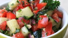 Chopped tomatoes, cucumbers, onions, and parsley combine with a drizzled dressing of lemon juice, olive oil, garlic, and mint leaves.