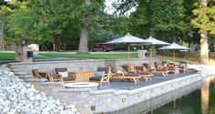 two tiered retaining wall on a lake.
