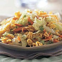 This chilled asian salad features great flavors and a delicious crunch from sunflower seed kernels, slivered almonds, and chuka soba, or Japanese curly noodles.