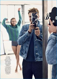 Sporting an AG denim jacket, Boyd Holbrook plays photographer for an infectious image from Esquire.