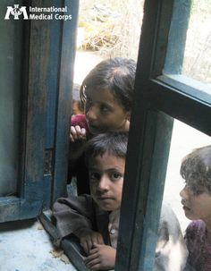July 21: Refugee children wait for a checkup at a health facility in Afghanistan. Photo: Fatima Mohsin, International Medical Corps, Afghanistan 2013