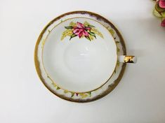 Shafford pedestal hand painted teacup and saucer. No chips, crazing or gold loss. Excellent condition. Beautiful set with orchids and lily of the valley. Please look at photos carefully as they are a part of my description. Note. Actual color may differ from the photo due to