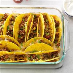 Baked Beef Tacos Recipe -We give tacos a fresh approach by baking the shells upright in refried beans and tomatoes. The bottom gets soft, and the top stays crisp and crunchy. —Patricia Stagich, Elizabeth, NJ