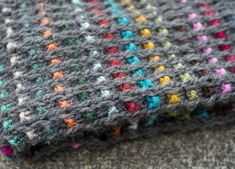 "This is a cowl that was inspired in part by Hundertwasser's art and architecture, hence the title Dunklebunt, which is a name that Hundertwasser gave himself and that means ""darkly multicolored.""Dunkelbunt was knit with Cascade Eco in the main, and I used bits and pieces of colorful worsted-weight wool from my stash for the little windows of colour.This is an easy project to knit and it is worked flat and then seamed, so it is suitable for beginners who are interested in learning a new ..."