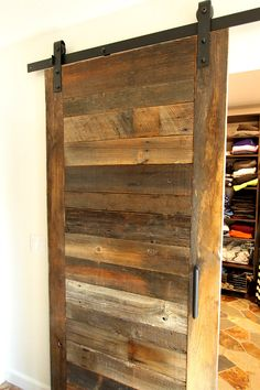 Major master bathroom remodel in a luxury home in the mountains near Lake Tahoe- before and after photos shared.  Bathroom designed in a rustic style.  Barn wood sliding closet door.