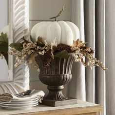 Why simply decorate for fall when you can make a statement? With our exclusive arrangement, that's just what you'll be doing. Handcrafted to recreate a classical interpretation of the noble pumpkin, this tall offering will command center stage on table, hearth and mantel.