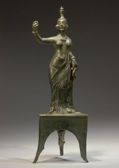 PARTHIAN BRONZE PRIESTESS WEARING AN ATTRIBUTE HEADPIECE  Chiton, and necklace. She stands upon and integrally cast tripodal platform.  2nd Century AD