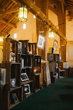love this display of photo's inside stacked wood crates. could also make for a cool ceremony backdrop.