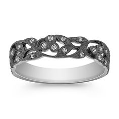 This unique vintage inspired ring combines round diamonds with intricate milgrain detailing. Twenty-three round diamonds, at approximately .10 carat total weight, are set in exquisite 14 karat white gold with a rich black rhodium finish.