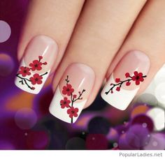 Long french nails with some red flowers