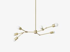 The Berkeley is a unique, organic fixture that delivers soft, even light. Each Berkeley is hand assembled in Los Angeles using brushed brass pipe and fittings and each fixture can vary slightly in its overall design.  This fixture is UL listed for both dry and damp locations. Damp listing is available upon request. The sockets are medium based E26 and the bulbs in the photo are G16.5  Production lead time is generally (4-5) weeks. Free domestic ground shipping.  Approximate dimensions…