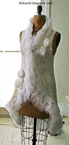 Wedding dress sleeve- less jacket. $599.00, via Etsy.