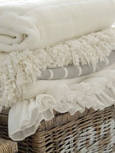 White and cream blankets in a basket, ruffles