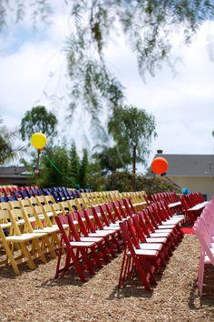 colorful wedding seating and rainbow colored wedding #weddingseating #rainbowwedding #weddingchicks http://www.weddingchicks.com/2014/02/04/country-fair-wedding/