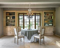 Lefèvre Interiors Photography Claude Smekens Built ins around window in dining room