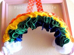 Sweet Rainbow Wreath by Fancy Frugal Life. Perfect for St. Patrick's Day!!