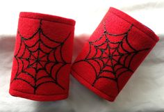 Spiderman Cuffs-this would be easy to make with red felt and black puff paint.