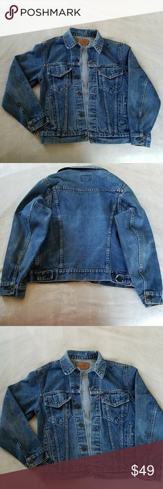 """VINTAGE LEVI'S TRUCKER'S JACKET VINTAGE LEVI'S TRUCKER'S JACKET with the traditional two button flap chest pockets and two side welt pockets. The fading throughout adds to the vintage vibe! On trend! What is old is new! There is one small worn spot on the back of left sleeve. See pic # 8. Size on label says 38. I have listed as a women's S based upon the actual measurements. Armpit to armpit is 19"""" and shoulder to hem length is 23.25"""". All measurements are approximate and taken flat. Levi's…"""