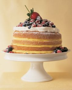 This frosting-free take on lemon cake features layers of textures and tastes, topped with whipped cream and fresh berries.