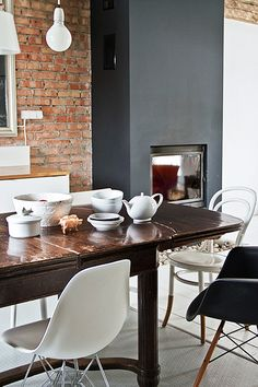 beautiful brick contrasted with a charcoal wall and clean lines. Joanna Gwis' Poland home