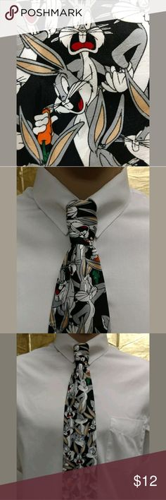 """Bugs Bunny 58"""" Necktie Thanks for stopping by to shop today!? You are viewing a Looney Tunes Bugs Bunny Men's Necktie.? This tie is 58"""" of FUN!? Multiple Bugs Bunny images adorn this tie with this carrots!? This tie a great addition to your wardrobe.? This item is in excellent used condition.? There are no rips, stains, or tears, and it comes from a smoke free, pet free home.? Item is sold AS IS. Please review the photos. Don't hesitate to contact the seller with questions about this item…"""