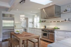 contemporary kitchen by Wm. F. Holland/Architect.  love the professional grade fridge and giant stove hood!!
