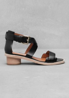 Classic leather sandal with a short stacked heel polished to a lovely raw finish.