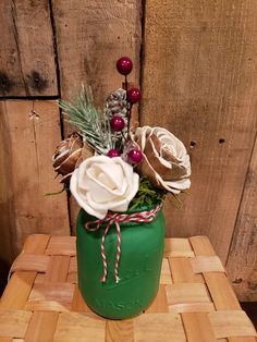 Christmas mason jar, hand painted filled with wood flowers, cinnamon stick, pine cone, greenery, etc.  Perfect for the holidays.  Rustic.