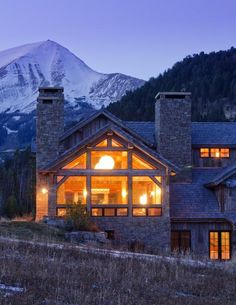 A custom ski chalet against the Big Sky mountain landscape