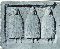 """Third Century Cucullati from Northumbria. The Hooded Spirits or Genii Cucullati are figures found in religious sculpture across the Romano-Celtic region from Britain to Pannonia, depicted as """"cloaked scurrying figures carved in an almost abstract manner."""" In Britain they tend to be found in a triple deity form, which seems to be specific to the Britain. The hooded cape was especially associated with Gauls or Celts during the Roman period. Their religious significance is still unclear."""