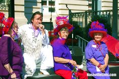Nashville Elvis Impersonator Chuck Baril with the Red Hat Ladies at the Southern Fried Festival.