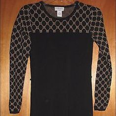 """Carmen Marc Valvo Black and Gold Sweater Dress S Carmen Marc Valvo black and gold sweater dress with long sleeves - size small.  Has belt loops but no belt.  63% rayon, 37% nylon.  In excellent condition.  Measurements: Chest:  16""""  from armpit to armpit Waist:  14""""  across the front Hips:  15""""  across the front Total Length:  36"""" Arm Length:  22"""" Carmen Marc Valvo Dresses Long Sleeve"""