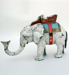 Hubley White Elephant Mechanical Bank » Circa 1934: Hubley Manufacturing Company began operation in 1894 and was located in Lancaster, Pennsylvania. They expanded their basic line of toys in the 1920s to include bookends, ashtrays, and doorstops