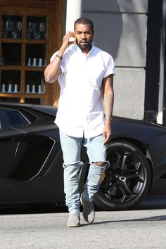 Kanye West hit the streets of LA in his bat-mobile style Lamborghini [PHOTOS]