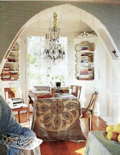 cozy nook with bookcases and dining room