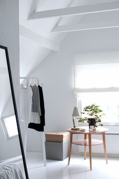 if you don't want to move around near the window (privacy reason etc.) in your walk in wardrobe, try a small table with plant!