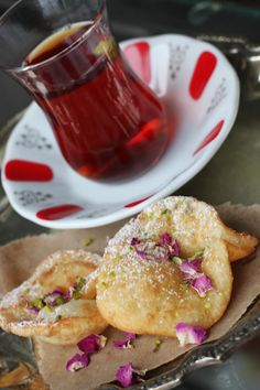Gosh-e Feel (Afghan Fried Pastries) The recipe only calls for 1 tsp of cardamom for a batch, but I recommend a little more. And add the seeds and leaves! I've also heard of some people adding a little rose water to the batter.