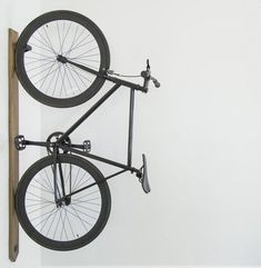 Finally a bike rack that's worthy of displaying your most prized possession. This vertical bike rack is designed to look just as good with or without your bike. Whether you're tight on space or simply want to feature your favorite ride - draw it out from the garage and into your living space. Constructed from solid hardwood and powder coated steel - it is built to last and can handle most sizes and styles. Installation consists of a unique mounting system that self-levels the rack along any…