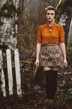 I like the orange shirt and the skirt but I would prefer the skirt longer