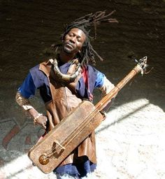 Nuru Kane getting down on the Moroccan Hajhouj or Guembri instrument the black Moroccans called the Gnawa.Nuru Kane is a Baye fall sufi of the Mystical Mouride Islamic sect founded by Cheick Amadou Bamba Mbakke & Cheikh Ibra Fall.Senegal stand up.