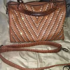 Stylish womens purse Cognac colored purse with crocodile pattern, rhinestones and shoulder strap. Has a tear in the zipper pocket on the inside but overall in great condition. Bags Hobos
