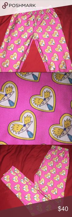 HEY ARNOLD! leggings Sz large omg! These hey Arnold leggings are one of a kind! Never warn and in pristine condition. Size large and ready for you to rock them and be the talk of the party! Perfect addition to any kitschy wardrobe! Thanks for looking in my closet! XOXO  NOT BLACKMILK. Just tagged for exposure. Blackmilk Pants Leggings