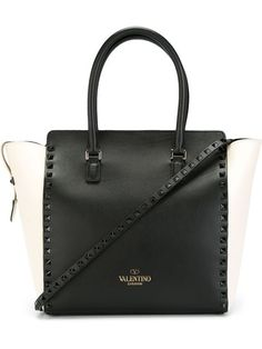 Shop Valentino Garavani 'Rockstud' trapeze tote in Birba's from the world's best independent boutiques at farfetch.com. Shop 300 boutiques at one address.