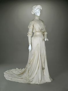 Wedding dress, silk charmeuse, linen needle lace, silk net and false pearls, c. 1910.