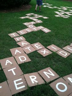 DIY Outdoor Scrabble or Bananagrams tiles. Take thin board, paint pens, or stencils and spray paint (with an adult's help) and turn a word game into an outdoor fun game! - This would be great for a literacy activities day.