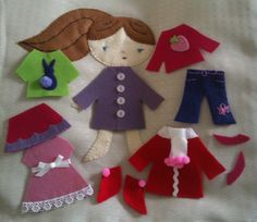 Paper doll style felt dress up doll cushion-felt appliqué on front of cushion with a pocket on the back for her clothes, which 'stick' felt on felt to enable the doll to be dressed up in various outfits