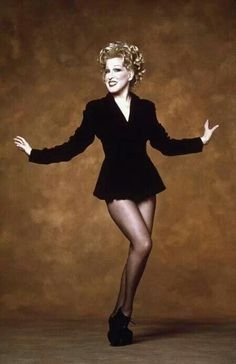 """I always try to balance the light with the heavy - a few tears of human spirit in with the sequins and the fringes."" - Bette Midler"