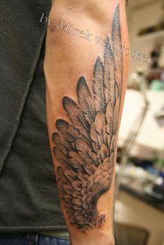black and grey wing tattoo by Mirek vel Stotker