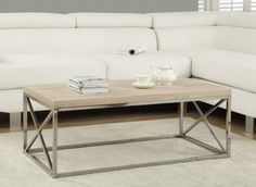 Coffee Table - Natural With Chrome Metal. With its natural  reclaimed wood-look top, this cocktail table gives an exceptional look to any room. Its original rectangular shape and chromed metal base provide sturdy support as well as a contemporary look. Use this multi-functional table to compliment your living room. * Sturdy chrome metal base * Natural reclaimed wood-look surface * Contemporary design * Original rectangular shape